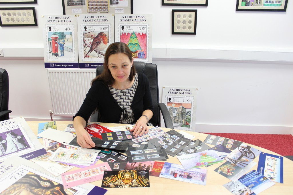 Designer Emma Cooke of EJC Design with the collection of Christmas stamps issued over the past 40 years