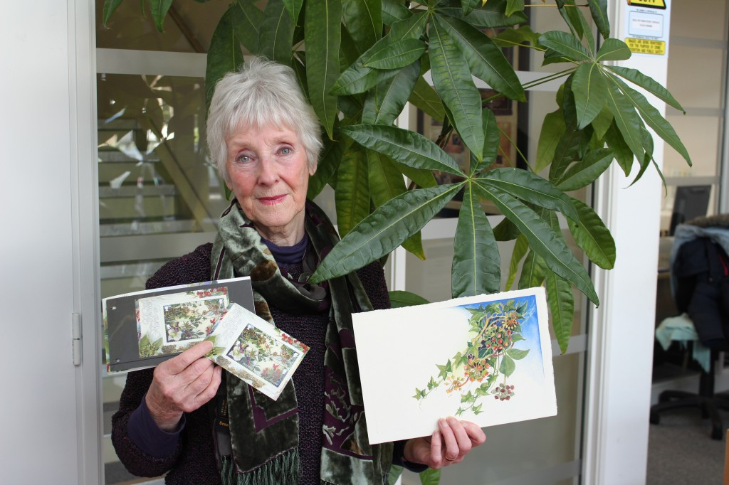 Local artist Catherine James with the Winter Flora miniature sheet due for release on January 6, 2014.