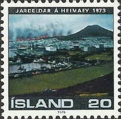 This stamp was released in 1975 and shows the 1973 Heimaey eruption